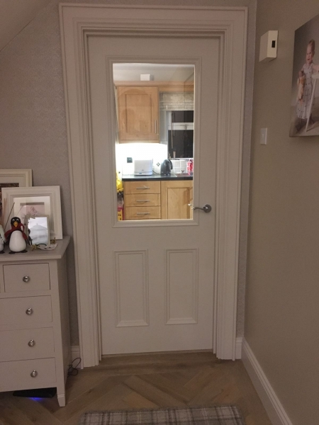 Solid wood interior door with glass